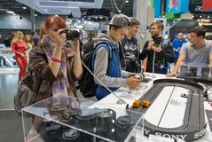 Sony photo camera booth during CEE 2017 in Kiev, Ukraine. People testing professional photographic cameras on Sony company booth during CEE 2017, the largest Stock Images
