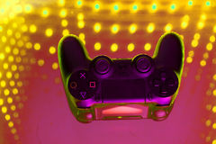 Sony play station on illuminated table. Game console royalty free stock images