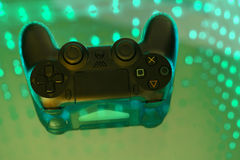Sony play station on illuminated table. Game console royalty free stock photos