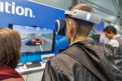 Sony PlayStation booth during CEE 2017 in Kiev, Ukraine. People visit Sony PlayStation home video game console company booth during CEE 2017, the largest Stock Photo
