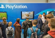 Sony PlayStation booth during CEE 2017 in Kiev, Ukraine. People visit Sony PlayStation home video game console company booth during CEE 2017, the largest Royalty Free Stock Images