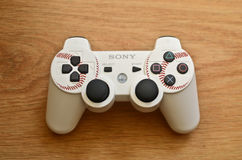 Sony Playstation controller. White Sony Playstation controller with wooden background Stock Images