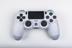 Sony PlayStation 4 game console with a joystick dualshock 4 on white background,  home video game console Stock Photo