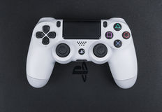 Sony PlayStation 4 game console with a joystick dualshock 4 on white background,  home video game console Stock Photos