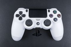 Sony PlayStation 4 Slim 1Tb revision and dualshock game controller. Game console with a joystick. Home video game console. Sankt-Petersburg, Russia, September 24 stock photos