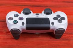 Sony PlayStation 4 Slim 1Tb revision and dualshock game controller. Game console with a joystick. Home video game console Stock Photo