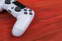 Sony PlayStation 4 Slim 1Tb revision and dualshock game controller. Game console with a joystick. Home video game console on wood Royalty Free Stock Photography