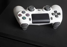 Sony PlayStation 4 Slim 1Tb revision and game controller Stock Images