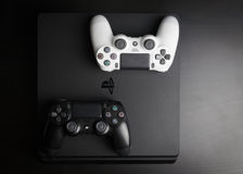 Sony PlayStation 4 Slim 1Tb revision and game controllers. Sankt-Petersburg, Russia - 14 August, 2017: Sony PlayStation 4 Slim 1Tb revision and game controllers Stock Photo