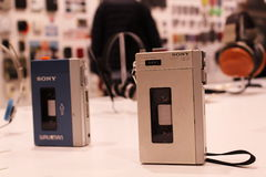 Sony Pressman and Walkman on Display. The two earliest Sony portable music players, the original Walkman and its predecessor the Pressman, on display at an stock images