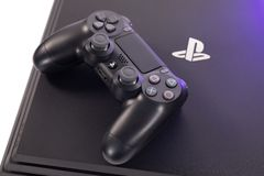 Sony`s Playstation 4 Pro Gaming Console and Controller royalty free stock images