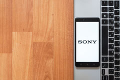 Sony on smartphone screen. Los Angeles, USA, july 18, 2017: Sony on smartphone screen placed on the laptop on wooden background Stock Photography