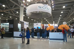 Sony stand in Crocus Expo. Moscow Crocus Expo, Moscow, Russia - April 20, 2017: Visitors came to Sony stand to try new cameras and lenses at Photoforum 2017 royalty free stock image
