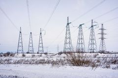 Supports overhead power lines in winter. royalty free stock photography