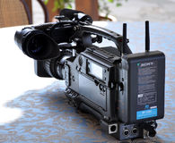 Sony video camera. Professional Movie Camera for production business, on table Stock Photos
