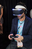 Sony VR Headset Morpheus System. A journalist playing with Morpheus, Sony Virtual Reality headset for PlayStation 4 at GDC 2014 on March 20, 2014 in San Stock Images