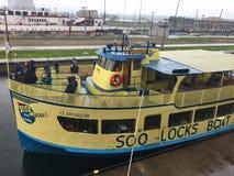 Soo Locks - boat. SAULT STE. MARIE, MI / USA - MAY 28, 2017: Soo Locks Boat Tour travels through the Soo Locks royalty free stock photos