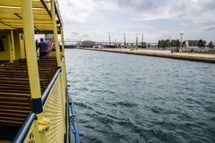 Soo Locks Boat Tour In Sault Ste Marie Michigan. Sault Ste Marie, Michigan, USA - August 9, 2015: Tour boat carries tourists into the world famous Soo Locks. The Stock Photos