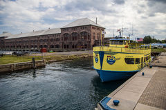 Soo Locks Boat Tours. Sault Ste. Marie, Michigan, USA - August 9, 2015. The Soo Locks Boat Tour takes visitors through the American and Canadian Soo Locks. The Royalty Free Stock Photo