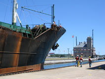 Soo Locks Passage. A ship is guided through one of the Soo Locks in Sault Ste. Marie, Michigan, Upper Stock Photos