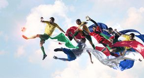 It is soocer game religion. Soccer players fighting for ball on sky background Royalty Free Stock Photography