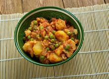 Sooka Aaloo Simla Mirch. Baby potatoes and crunchy bell peppers make this dish in Punjabi Style Royalty Free Stock Images