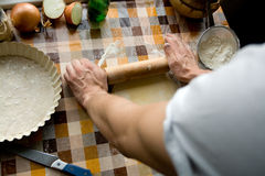 Sooking and home concept - close up of male hands kneading dough. On a background in cell Royalty Free Stock Photos