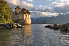 Soon autumn. A medieval fortress Chillon on lake Leman on a sunset stock photography