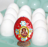 Soon holiday of Easter. White eggs in the container and a decorative Easter egg Royalty Free Stock Image