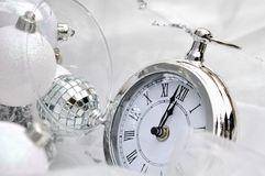 Soon midnight. Silver clock retro style overlooking midnight royalty free stock images