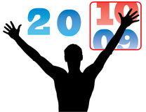 Soon new year. Young man changed the numbers on a calendar year from 2009 to 2010 Stock Image