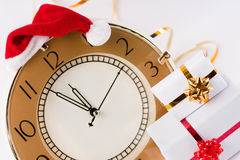 Soon the New Year. The clock showed almost 12.00 in the Santa hat and gifts stock image