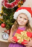 Soon new year!. Little girl at a Christmas fir-tree stock photography
