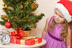 Soon new year!. Little girl at a Christmas fir-tree royalty free stock image
