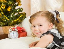 Soon new year!. Little girl at a Christmas fir-tree stock photos