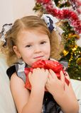 Soon new year!. Little girl at a Christmas fir-tree royalty free stock photography