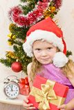 Soon new year!. Little girl at a Christmas fir-tree stock photo