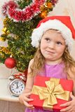 Soon new year!. Little girl at a Christmas fir-tree royalty free stock photo