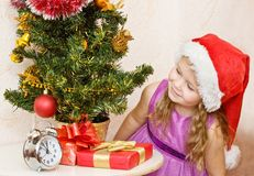 Soon new year!. Little girl at a Christmas fir-tree royalty free stock images