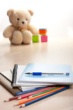 Soon the school. Notebooks, pens on the table Royalty Free Stock Image