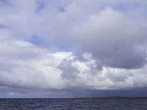 Soon storm. Thunderclouds hanging over the sea Royalty Free Stock Photo