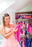 Pregnant woman in front of wardrobe in childs room Royalty Free Stock Photo