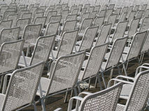 Soon it will be full of people!. Big amount of chairs in rows (side-view Stock Images