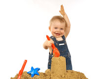 Sooooo big. Child playing with sand Royalty Free Stock Image