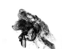 Soot. Black smoke. Black smoke on a white background Stock Images