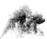 Soot. Black smoke. White steam on a black background closeup. Smoke Royalty Free Stock Images