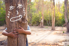 Soothe the Tree. Save Forest concept, woman give a hug to soothe the crying tree in the forest Royalty Free Stock Images