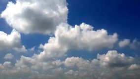 Soothing clouds in deep blue sky stock video footage