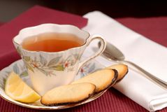 Soothing cup of tea in china cup. With lemon and cookies royalty free stock photo