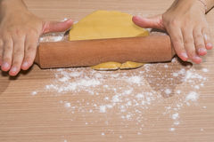 Soothing dough. Smoothing dough with a rolling pin Royalty Free Stock Photos